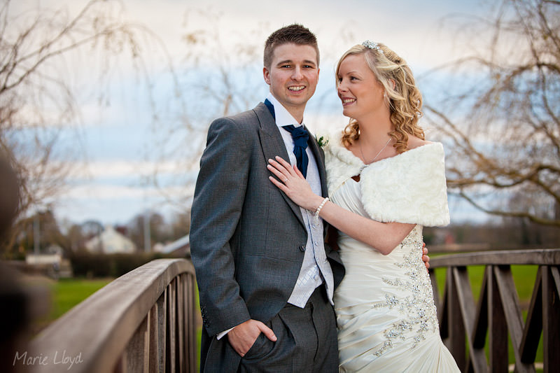 Bride and groom portraits on bridge at Grosvenor Pulford