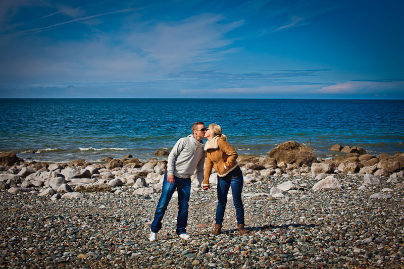 Llandudno beach engagement, kissing by the sea