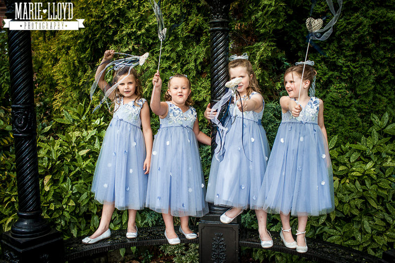 Four  young flower girls in aple blue and silver
