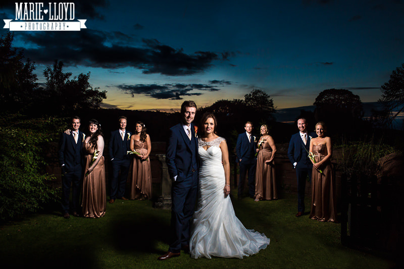 Fantastic Ruthin Castle group wedding photograph with couples all lit individually