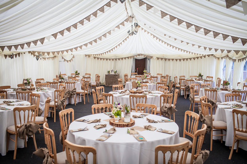 Beautiful marquee wedding with a natural woodland theme and lots of hessian