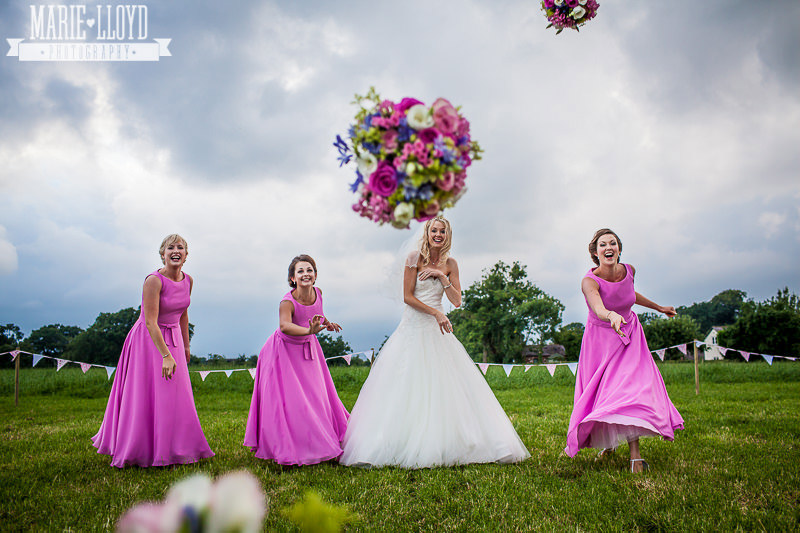 Bridal party throwing flowers