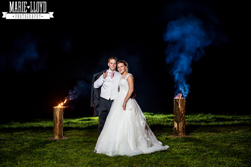 Tree stumps cut and lit at marquee wedding to provide light