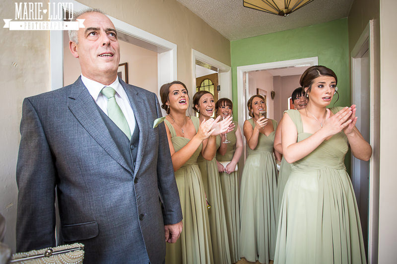 And her father looks on with bridesmaids