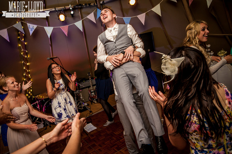 Groom getting a lift on the dancefloor