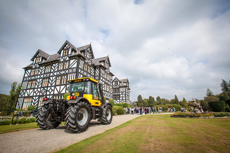 Gregynog Hall wedding with a JCB as the wedding car
