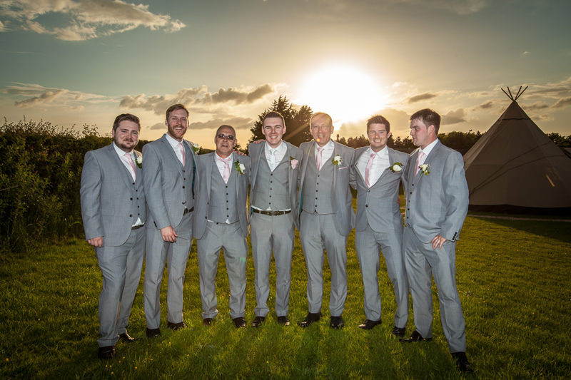 Sunset shot of the grooms party at a North Wales Tipi wedding