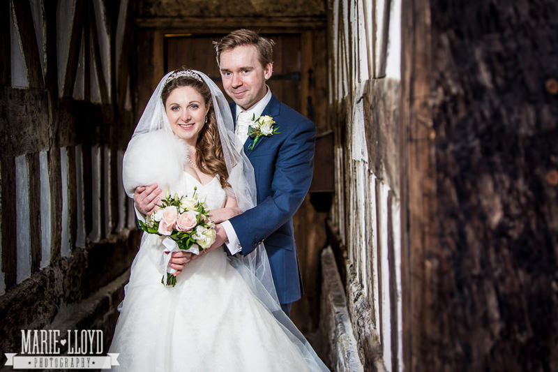 Adlington Hall wedding photographer in the corridor of the Tudor Hall
