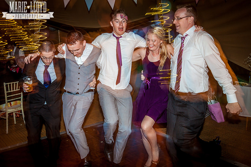 everyone dancing like crazy at a tipi wedding in north wales