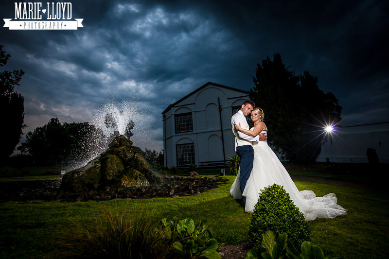 Plas Isaf wedding, evening shot with the fountain and a moody sky