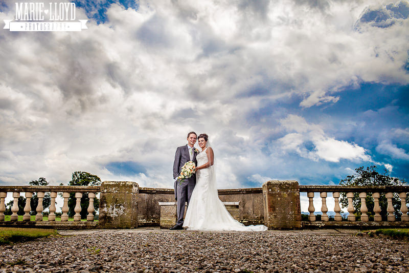 Willington Hall wedding, low shot with bride and groom and lots of sky