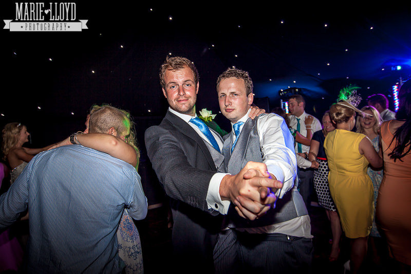 Guys dancing at a marquee wedding