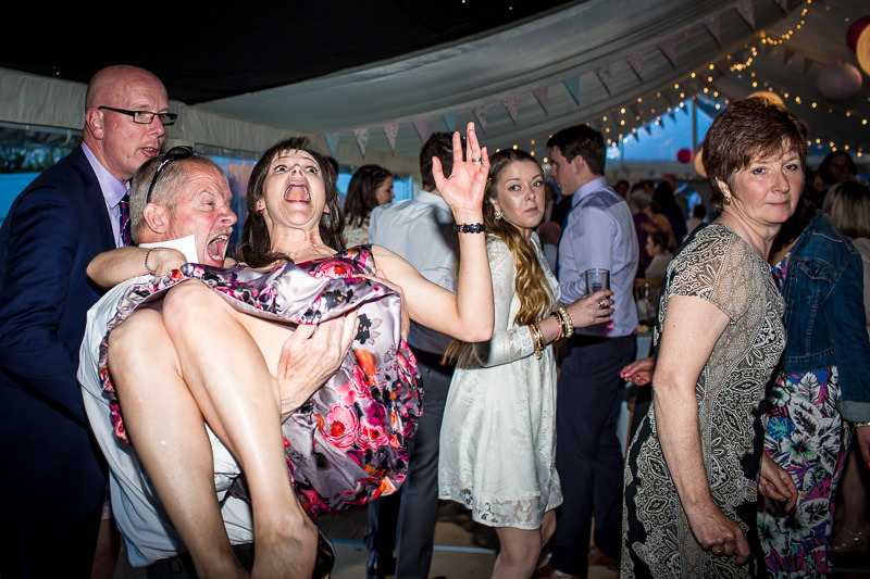 Terrified looking girl getting picked up on dance floor