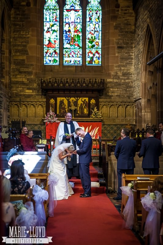 Bride and groom fall about laughing at their Liverpool Church wedding - from behind