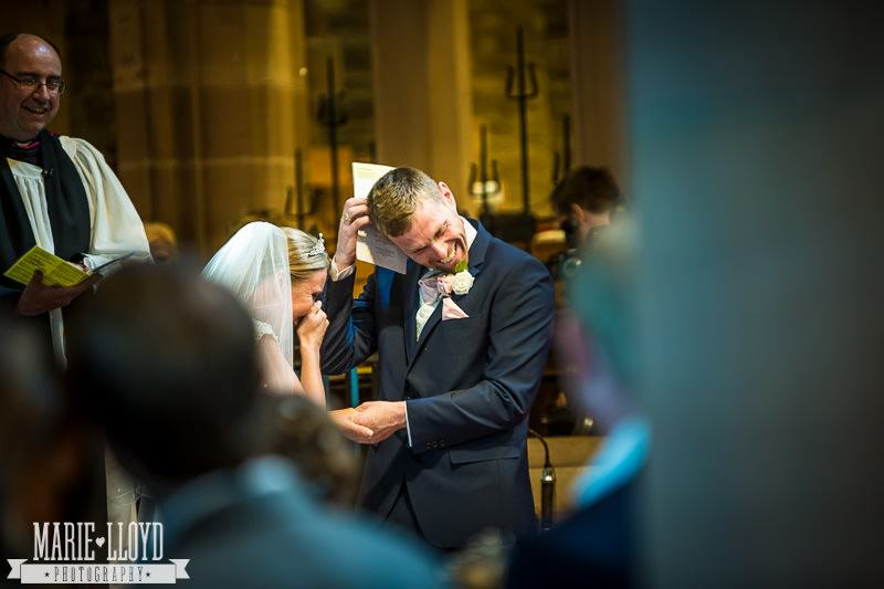 Bride and groom fall about laughing at their Liverpool Church wedding - from the front