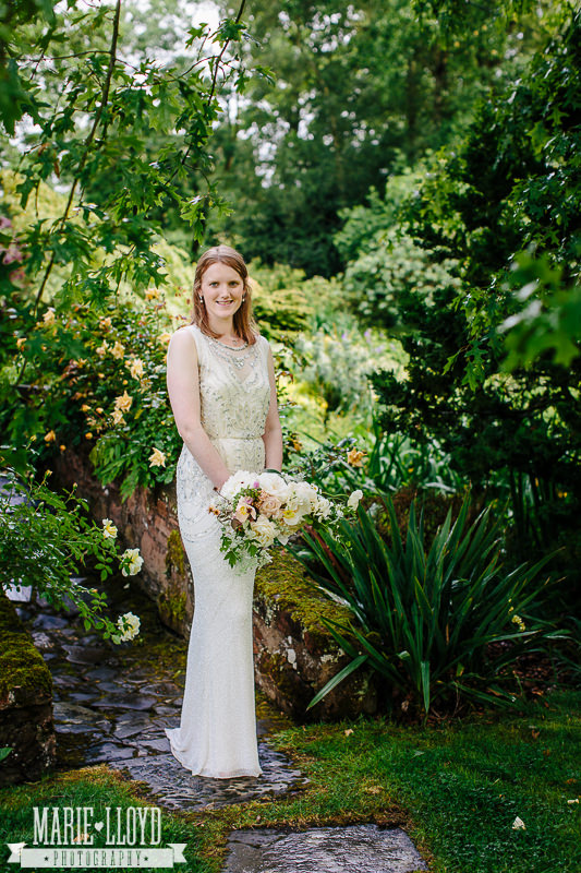 Lucy in the gardens of Lower Hall Worfield in Shropshire, wearing her stunning Jenny Packham dress