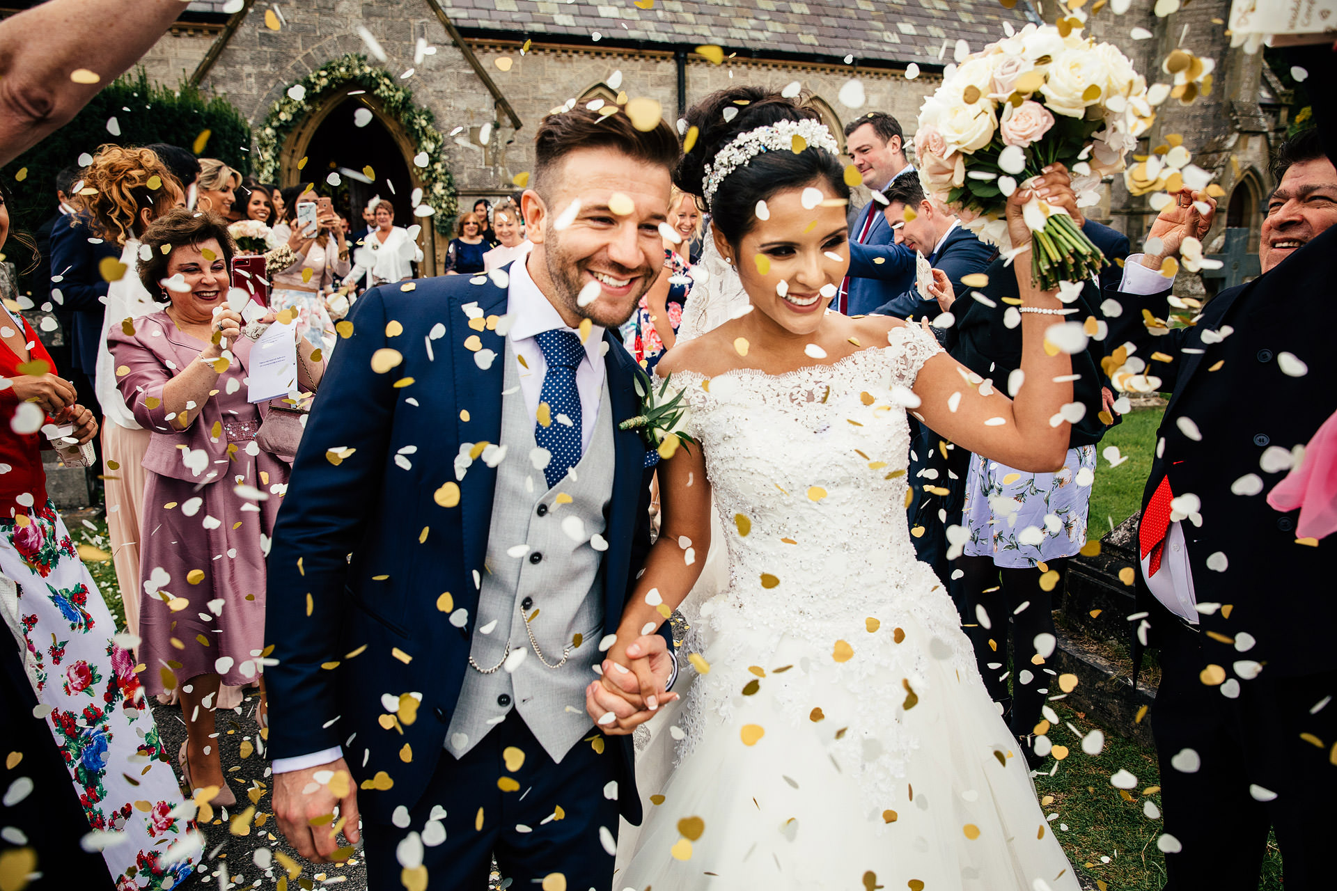 Confetti being thrown over wedding couple