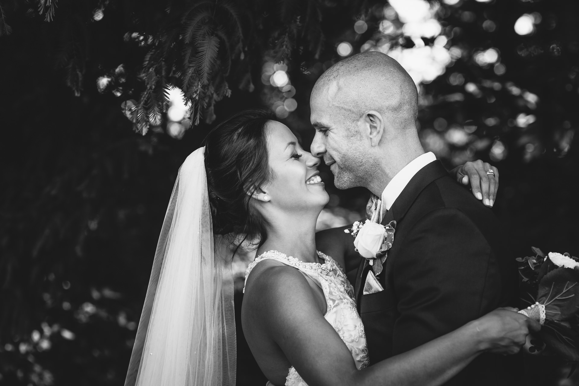 WEDDING PHOTOGRAPHY at inglewood manor with bride and groom touching noses
