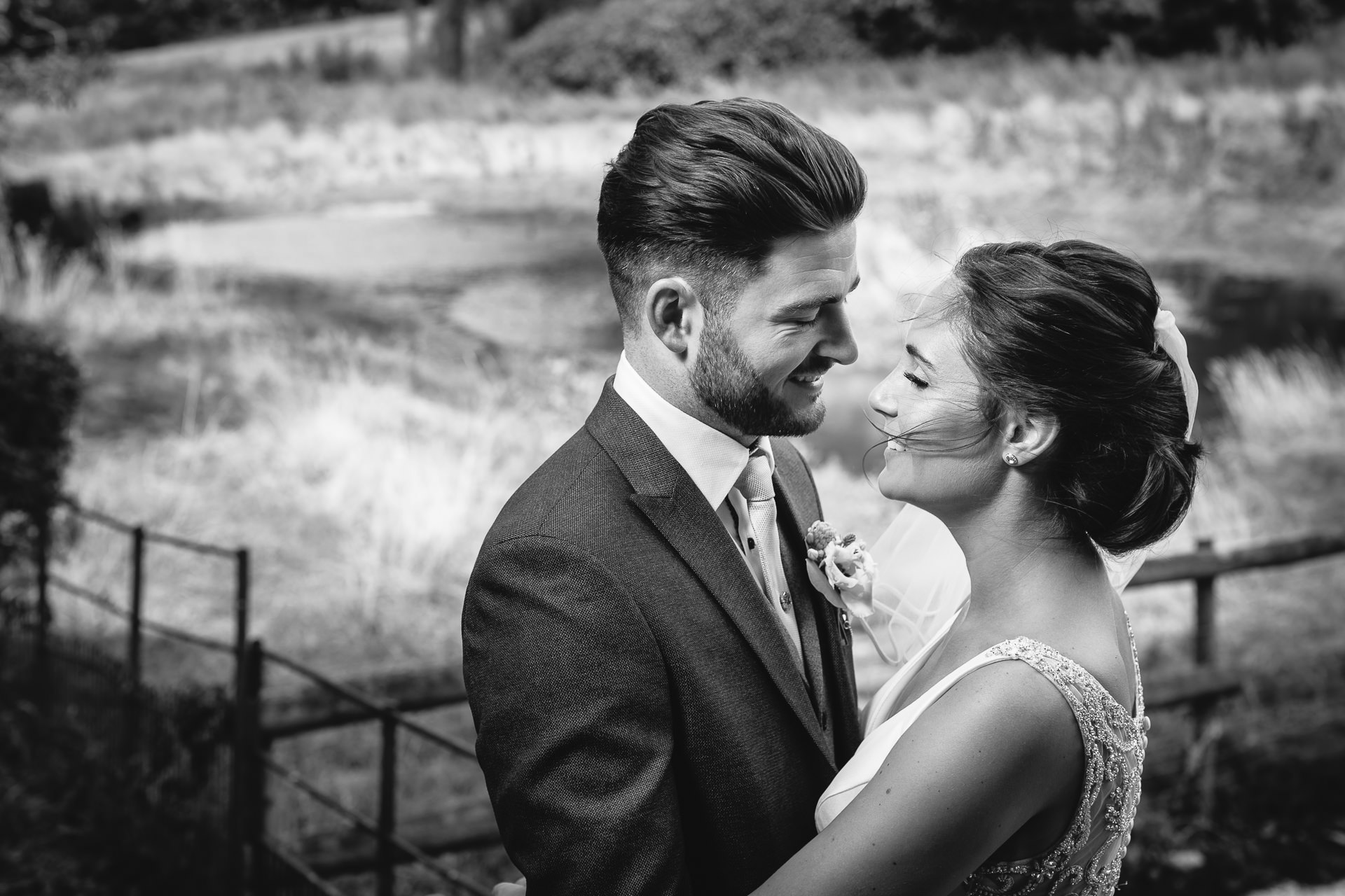 black and white wedding couple kissing at tyn dwr hall