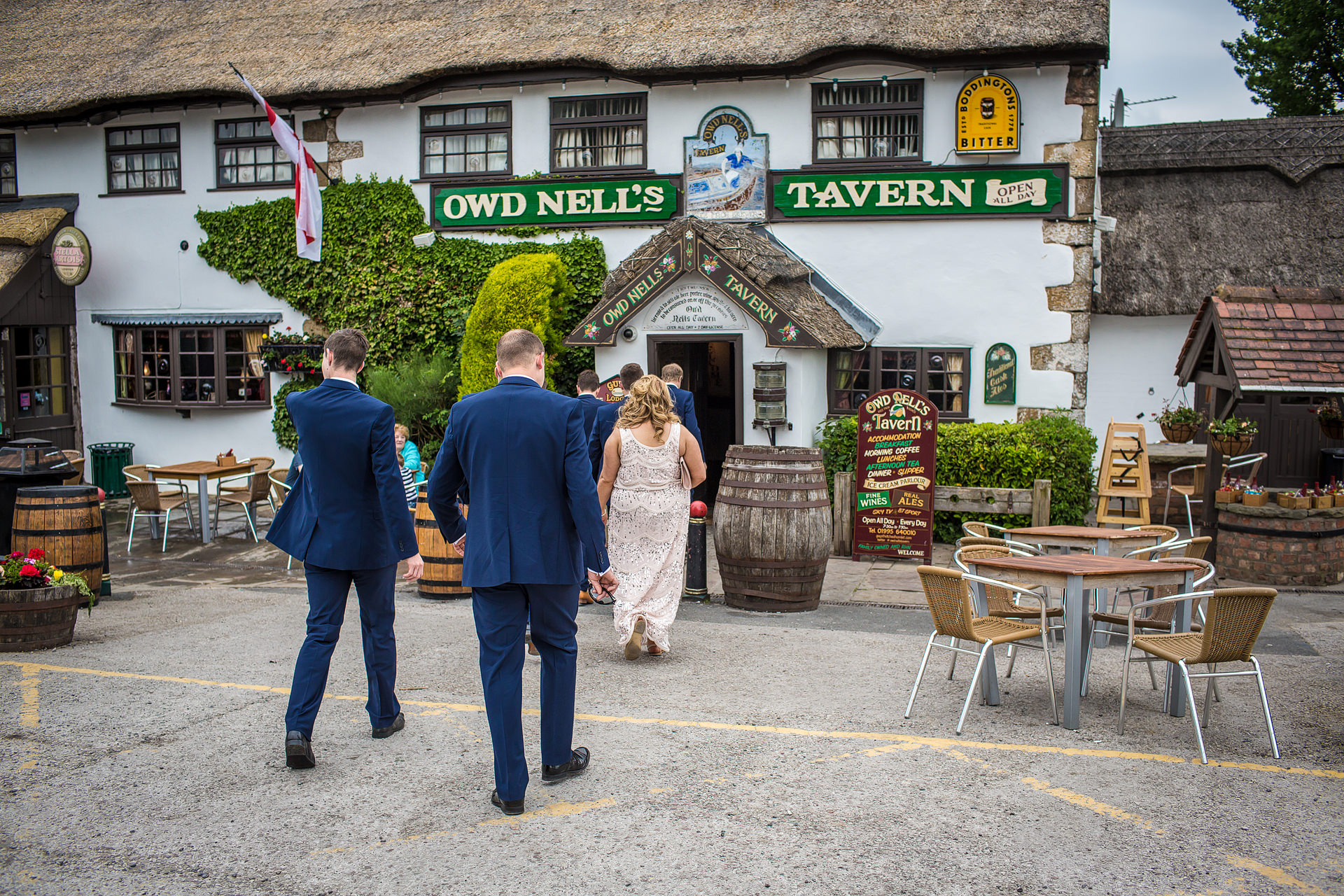 Groomsmen entering pub