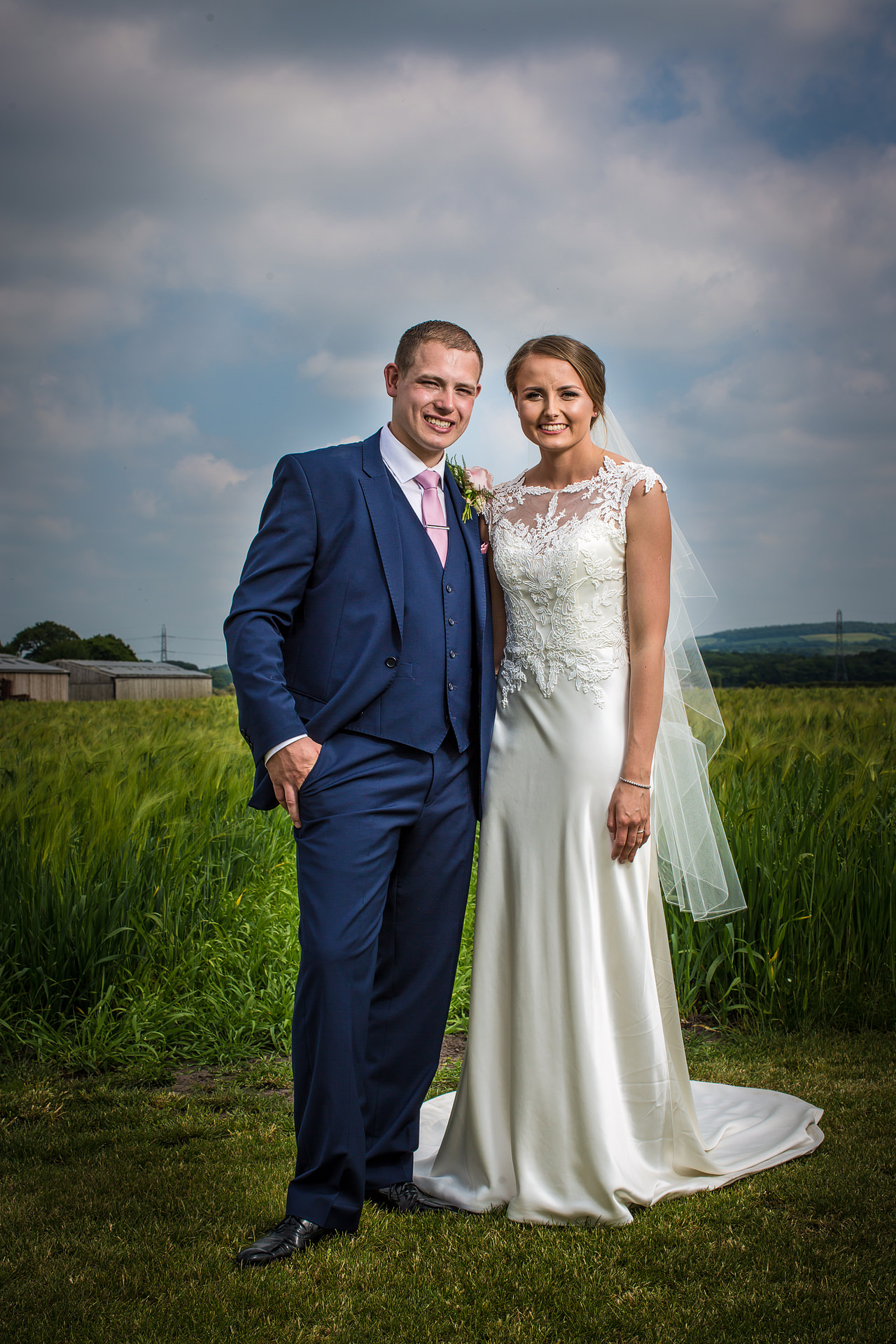 wedding couple portrait in farm field