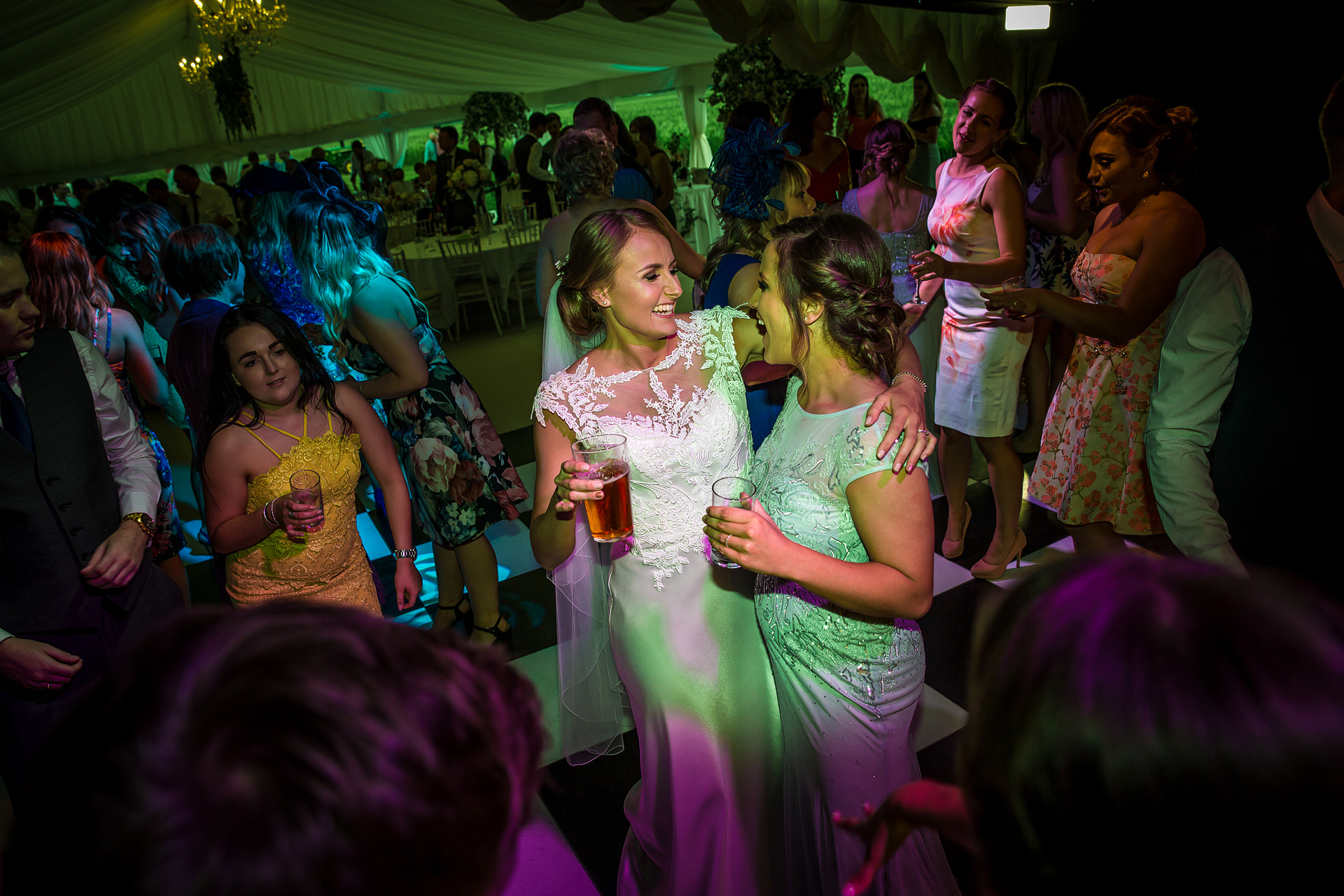 bride dancing with guests at wedding