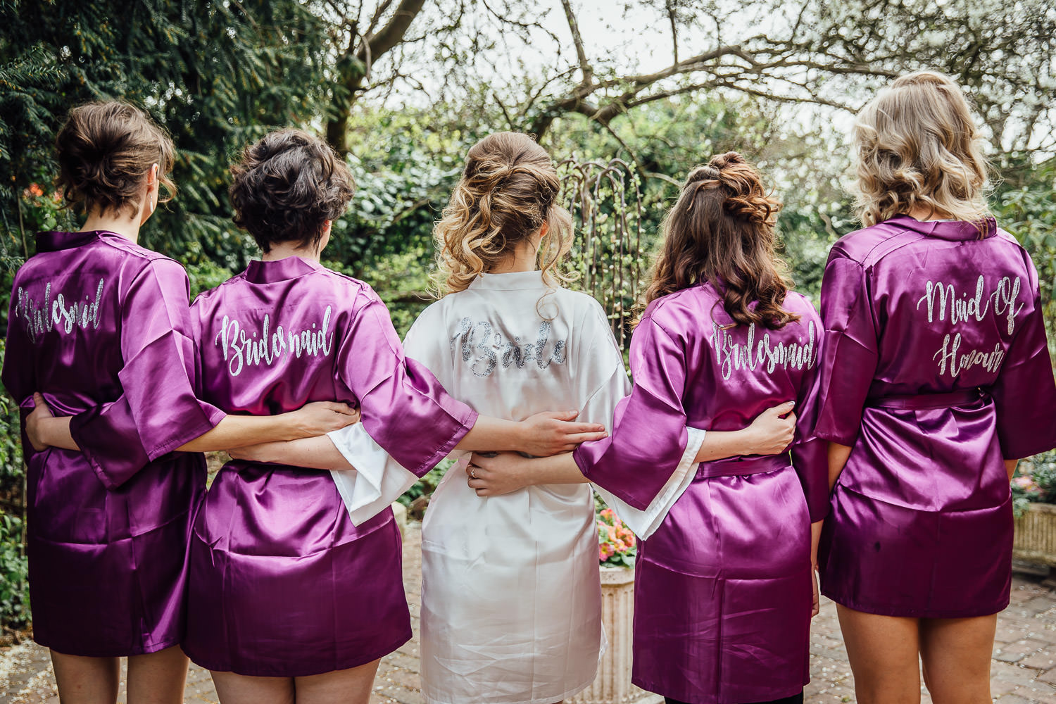 Bride and Bridesmaids with wedding dressing gowns on