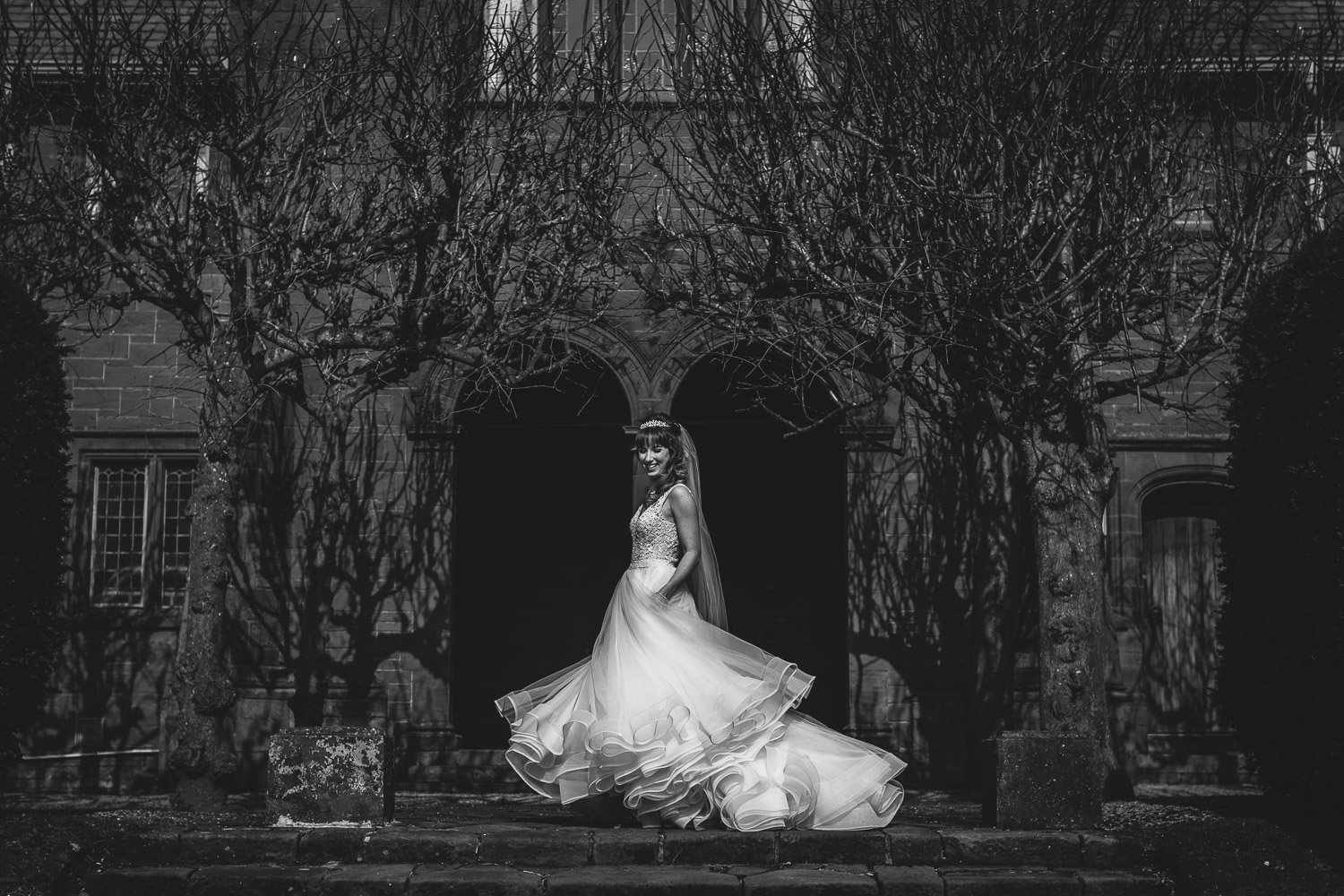 Bride twirling her wedding dress at Thornton Manor, wirral