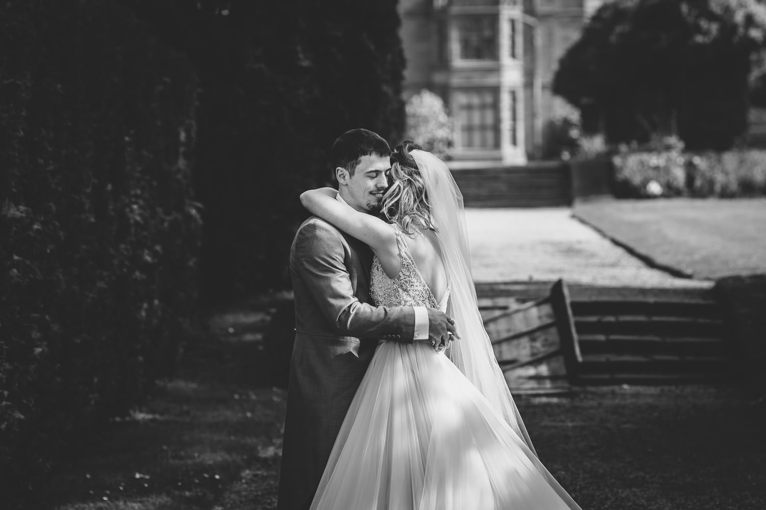 Bride and groom hugging in thornton manor Wirral