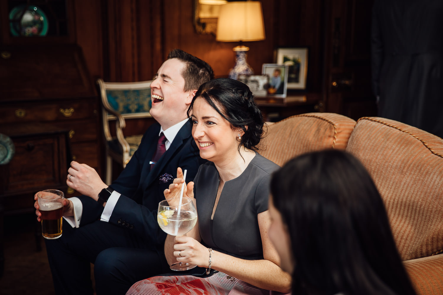 Wedding guests laughing in the Thornton Manor in the Wirral