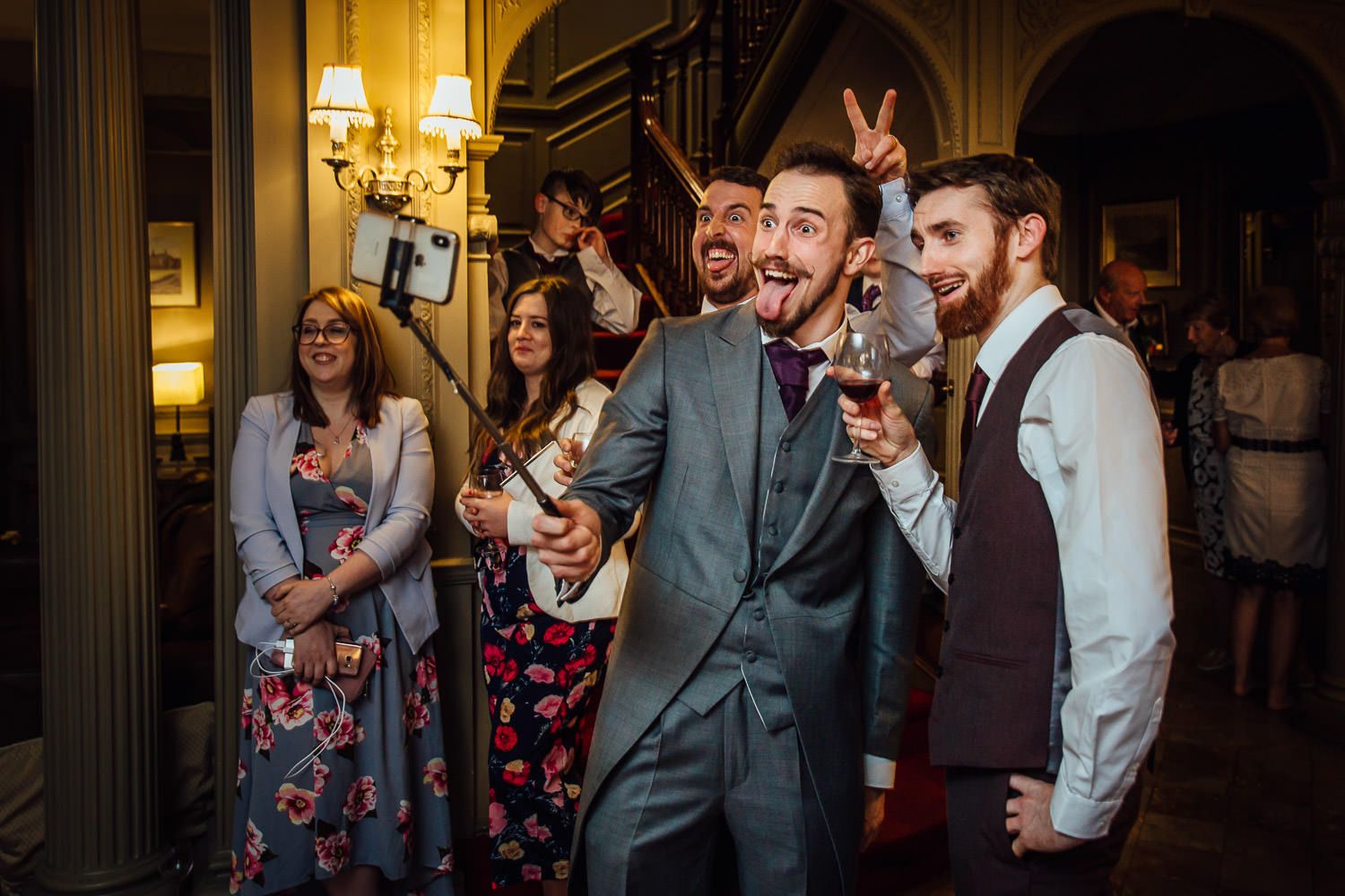 Wedding guests talking selfies at Thornton Manor
